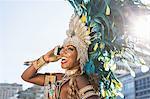 Samba dancer using cellphone, Ipanema Beach, Rio De Janeiro, Brazil