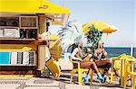 Samba dancers taking a break, Ipanema Beach, Rio De Janeiro, Brazil