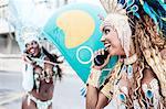 Samba dancers using pay phones, Ipanema Beach, Rio De Janeiro, Brazil