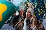 Samba dancers using pay phone, Ipanema Beach, Rio De Janeiro, Brazil