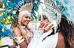 Samba dancers with cellphone, Rio De Janeiro, Brazil