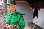 Senior Baseball Player in the Dugout.