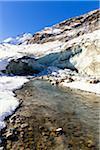 Morteratsch Glacier and Creek Ova da Morteratsch in first snow in Autumn, Val Morteratsch, Canton of Graubunden, Switzerland