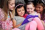 Children looking at digital tablet