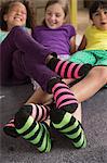 Three girls wearing brightly coloured socks