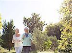 Senior women jogging in park