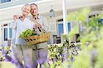 Portrait of senior couple hugging in garden