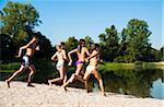 Kids Running on Beach by Lake, Lampertheim, Hesse, Germany