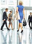 Business people walking in office lobby