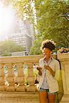 Woman enjoying chat on mobile phone
