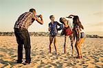Man photogrpahing friends on Mission Beach, San Diego, California, USA
