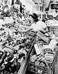 1950s 1960s WOMAN SELECTING FRESH