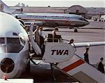 1960s PASSENGERS DEPLANING BOEING 727 TWA JET NEWARK AIRPORT NEW JERSEY