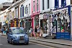 Trendy shops and taxi, Pembridge Road, Notting Hill, London, England, United Kingdom, Europe