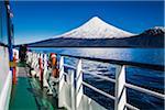 Close-up of tour boat on Cruce Andino, looking toward Osorno Volcano, Lake Todos los Santos, Parque Nacional Vicente Perez Rosales, Patagonia, Chile