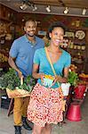 Two people in a farm shop, choosing organic vegetables.