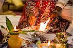 Bride and Groom performing Fire Ritual at Hindu Wedding Ceremony, Toronto, Ontario, Canada