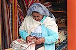 Woman embroidering, Otavalo market, Imbabura Province, Ecuador, South America