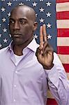 Man making the pledge of allegiance