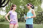 Female joggers taking a break in park