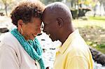 Senior couple face to face, smiling