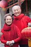 Senior Couple Holding Chinese Lantern