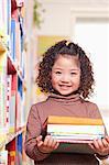 Little Girl Carrying Books