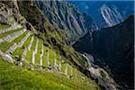 Close-up of terraced mountain side with stone walls, Machu Picchu, Peru