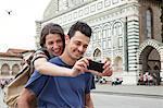 Young couple outside Santa Maria Novella church, Florence, Tuscany, Italy