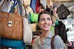 Young woman shopping, San Lorenzo market, Florence, Tuscany, Italy