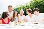 Family celebrating grandfather's birthday