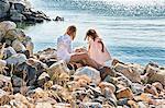 Mother and daughter on rocks, Utvalnas, Gavle, Sweden