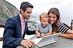 Young family with laptop, Casa Alto Vidigal, Rio De Janeiro, Brazil
