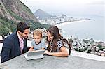 Young family using laptop, Casa Alto Vidigal, Rio De Janeiro, Brazil