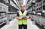 Portrait of worker in engineering warehouse
