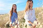 Teenage girls in field, Tuscany, Italy
