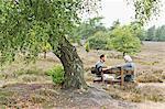 Senior man and mid adult man sitting on bench