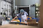 Man packaging vegan cheese in warehouse