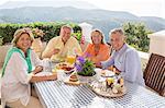 Senior couples enjoying breakfast on patio