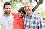 Multi-generation men smiling