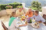 Senior couples enjoying breakfast on balcony