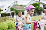 Girl riding bicycle in backyard