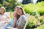 Multi-generation women laughing in backyard