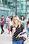 University student holding coffee