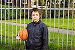 Portrait of serious boy street basket player