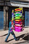 Man Carrying stack of Pinatas, Quito, Ecuador