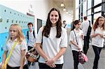 Schoolchildren in school corridor