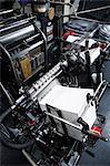 Paper printing machine at work in print workshop