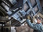 Engineer smoothing welds in factory