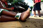 Woman wearing traditional foot bracelets, Drakensberg, Kwa-Zulu Natal, South Africa